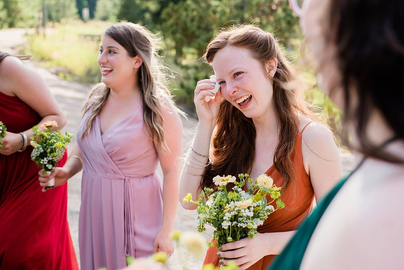 bride's sister crying after wedding ceremony photo