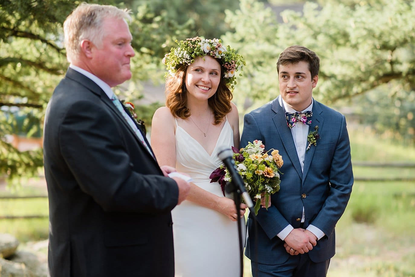father of the bride toasts outdoor reception photo