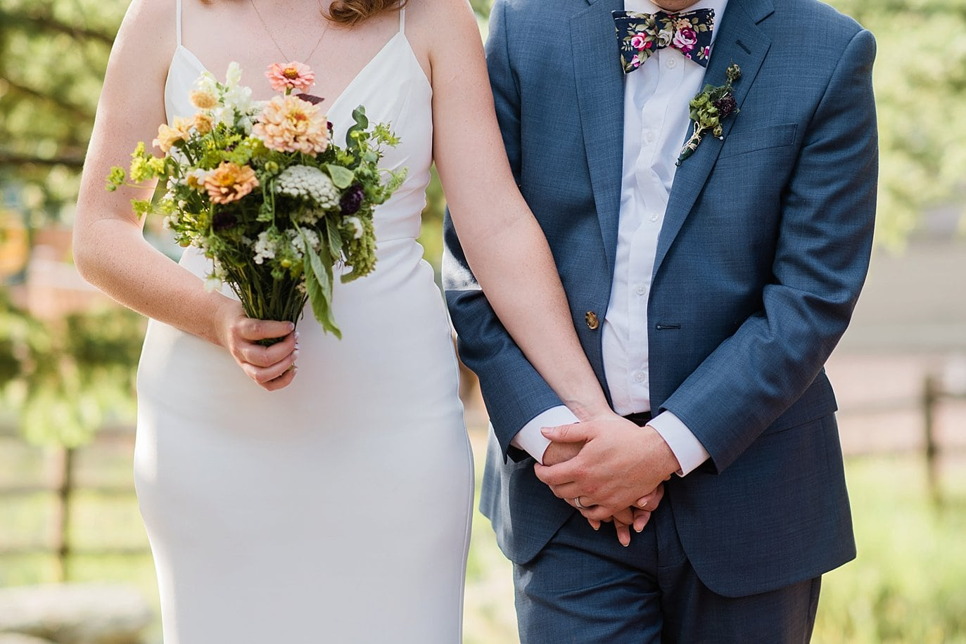 bride and groom holding hands photo