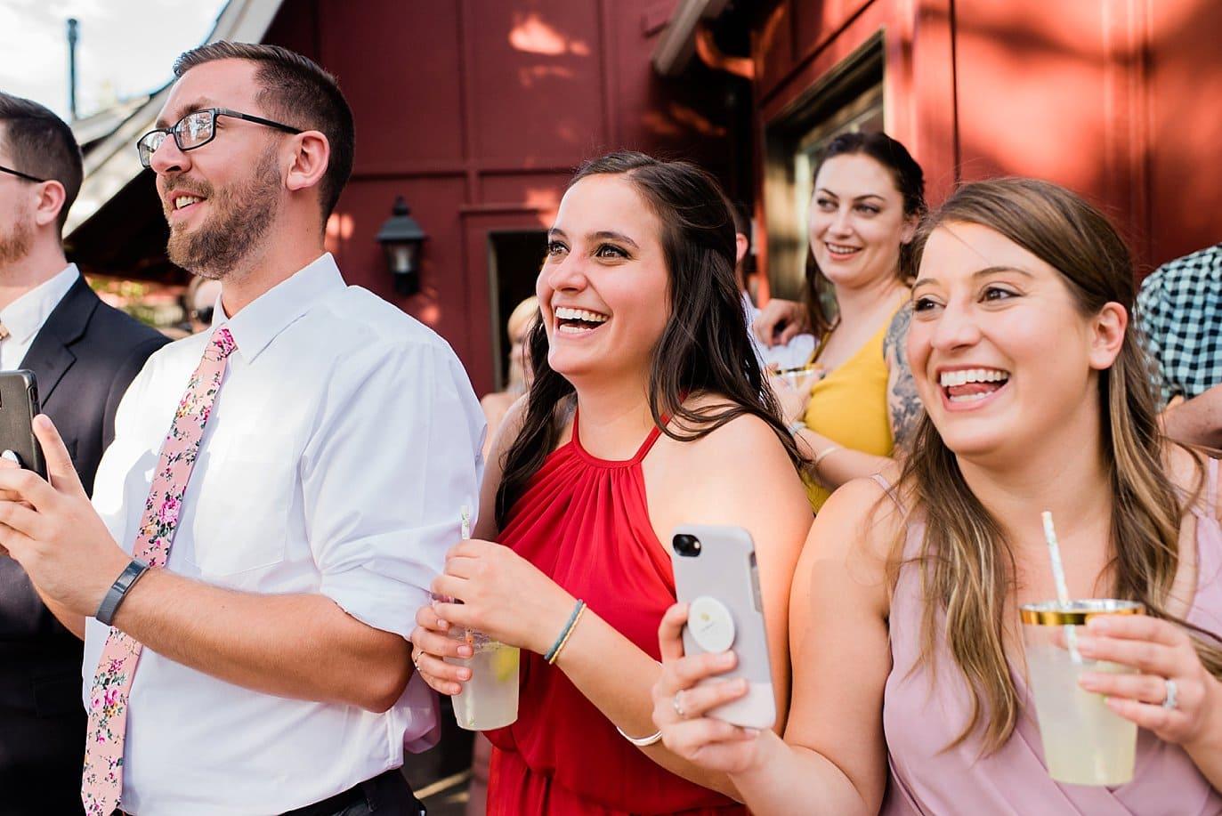 outdoor toasts Evergreen Red Barn wedding photo
