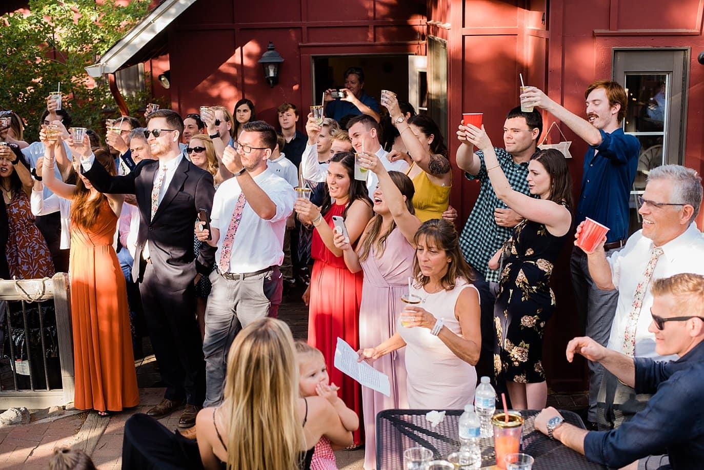 group cheers outdoor Colorado wedding photo
