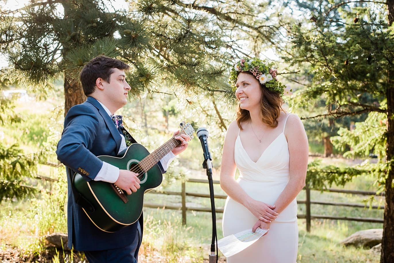 bride and groom sing John Prine song to each other at outdoor wedding reception photo