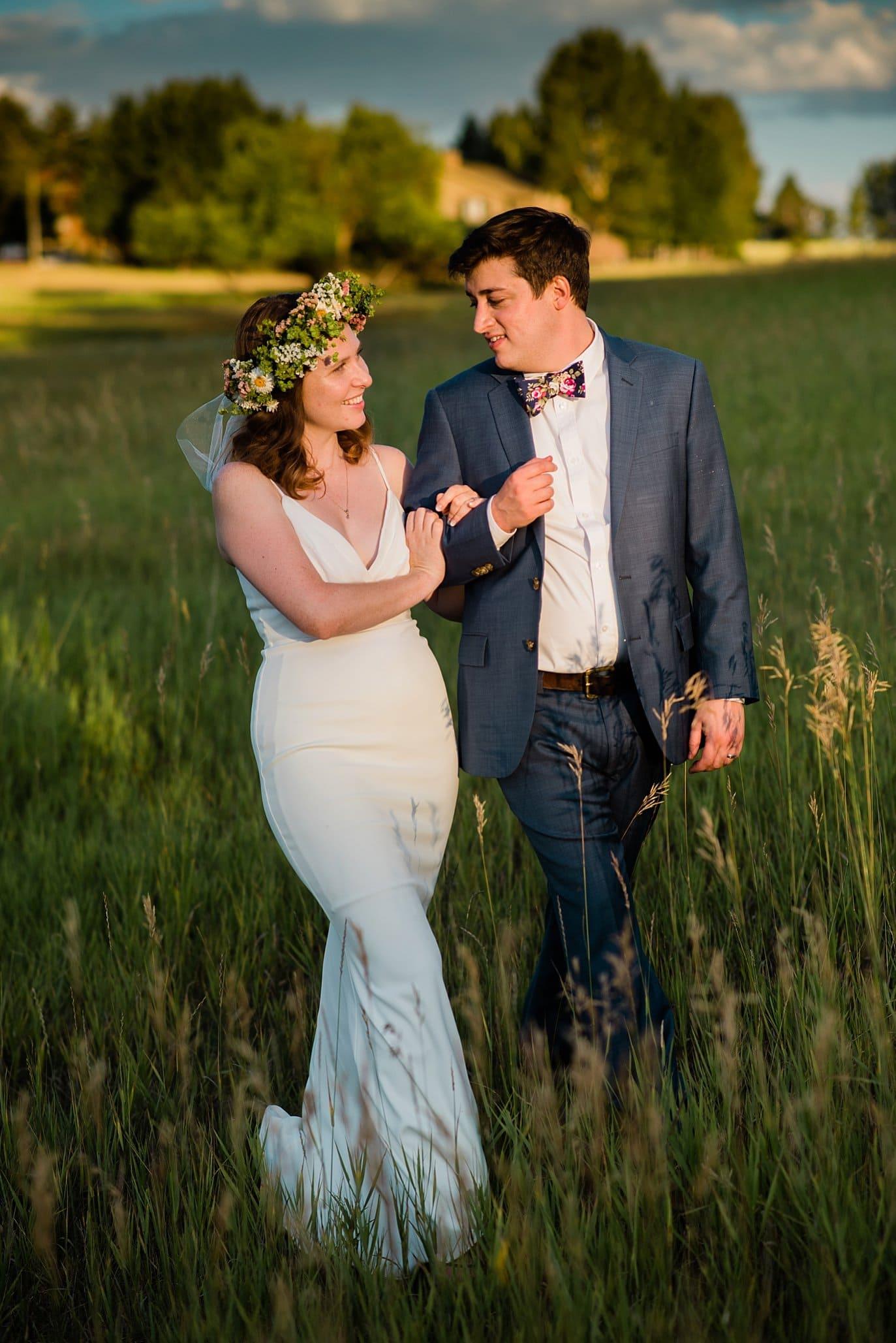 sunset walk in fields of Colorado wedding photo
