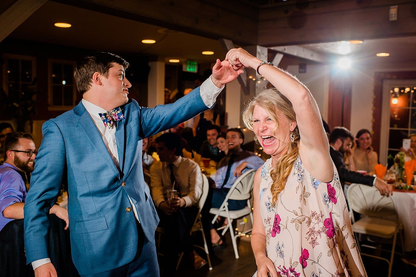 groom dances with mother of the bride photo