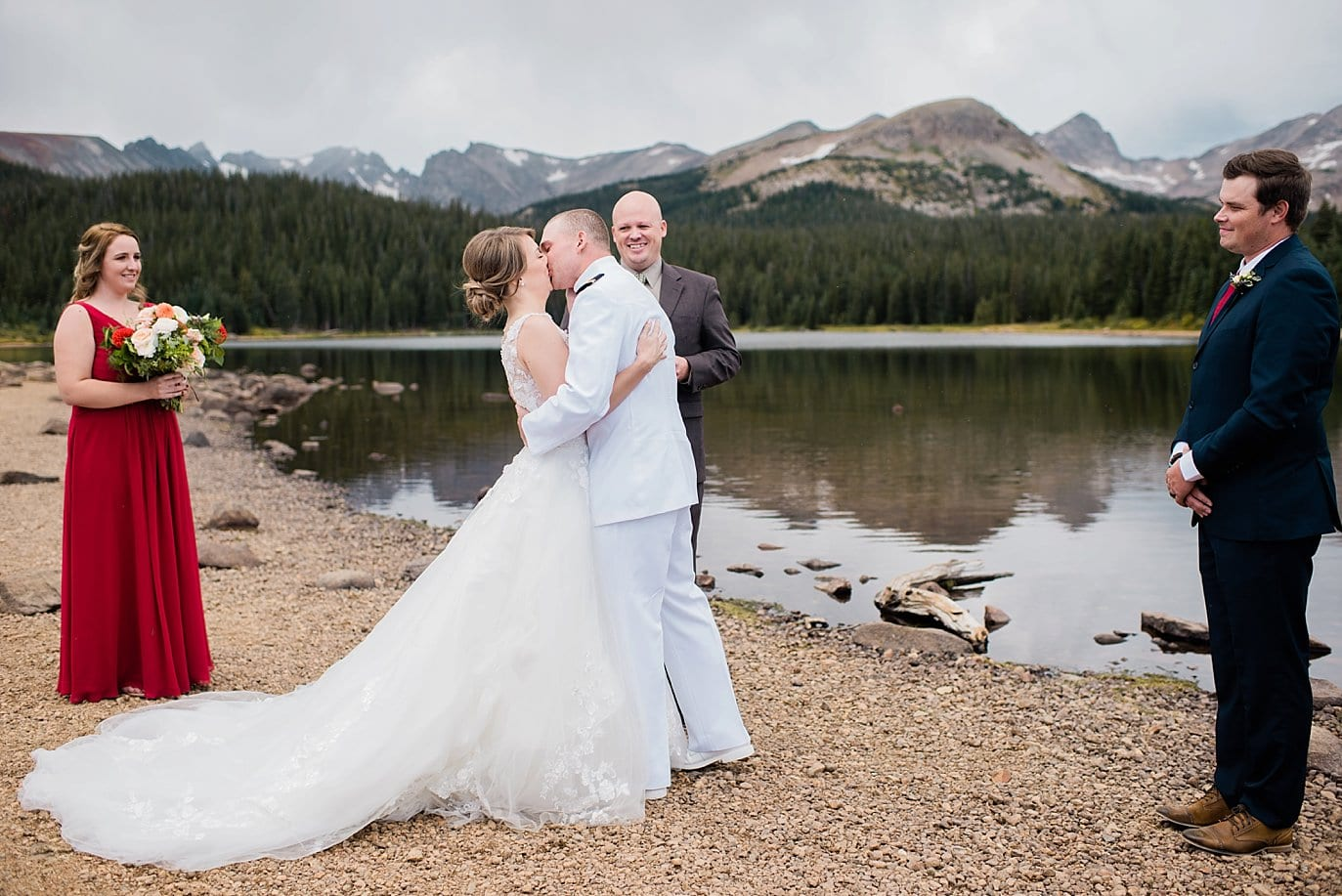 first kiss by Brainard Lake at Colorado fall wedding
