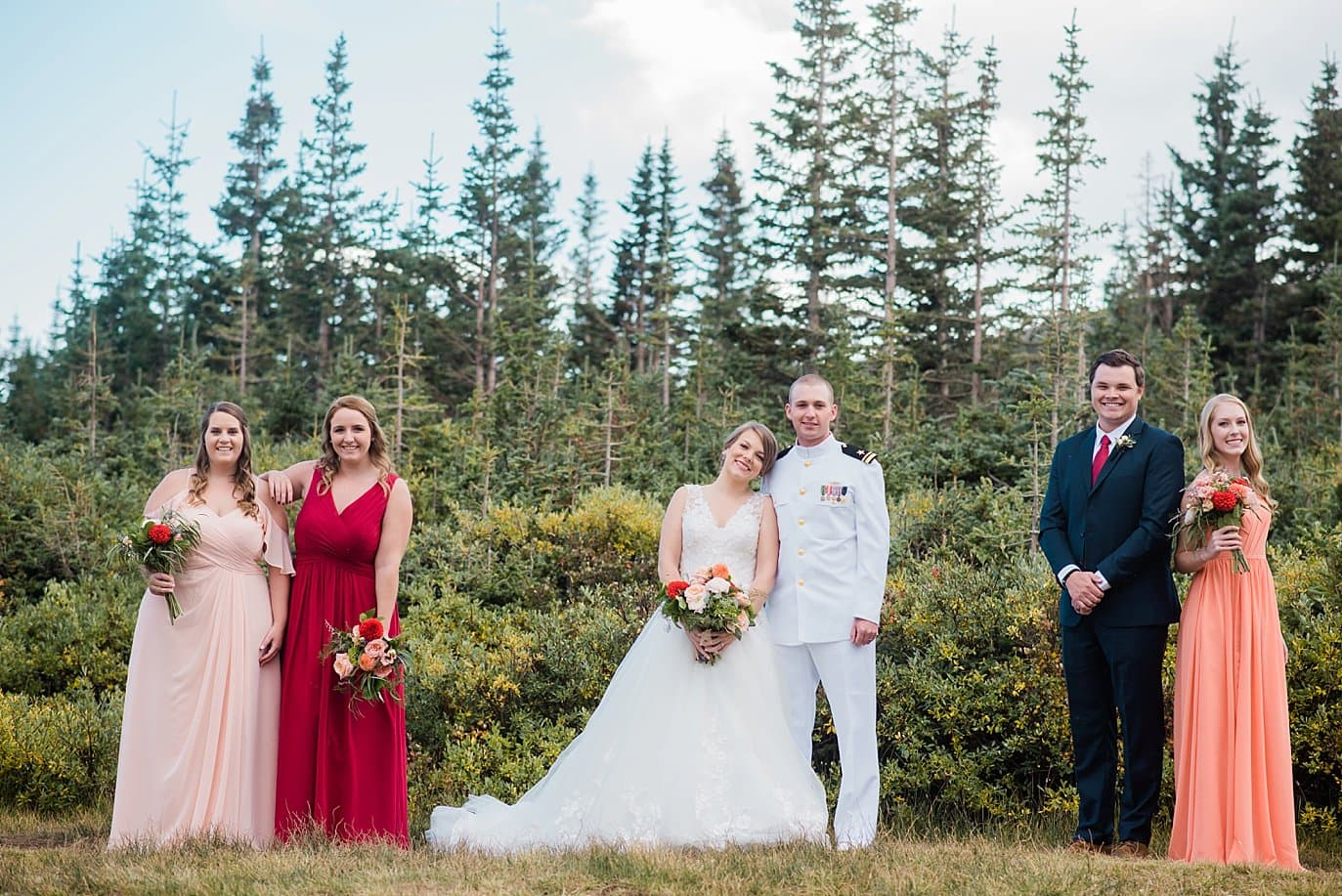 bridal party in shades of peach and navy at Colorado outdoor elopement