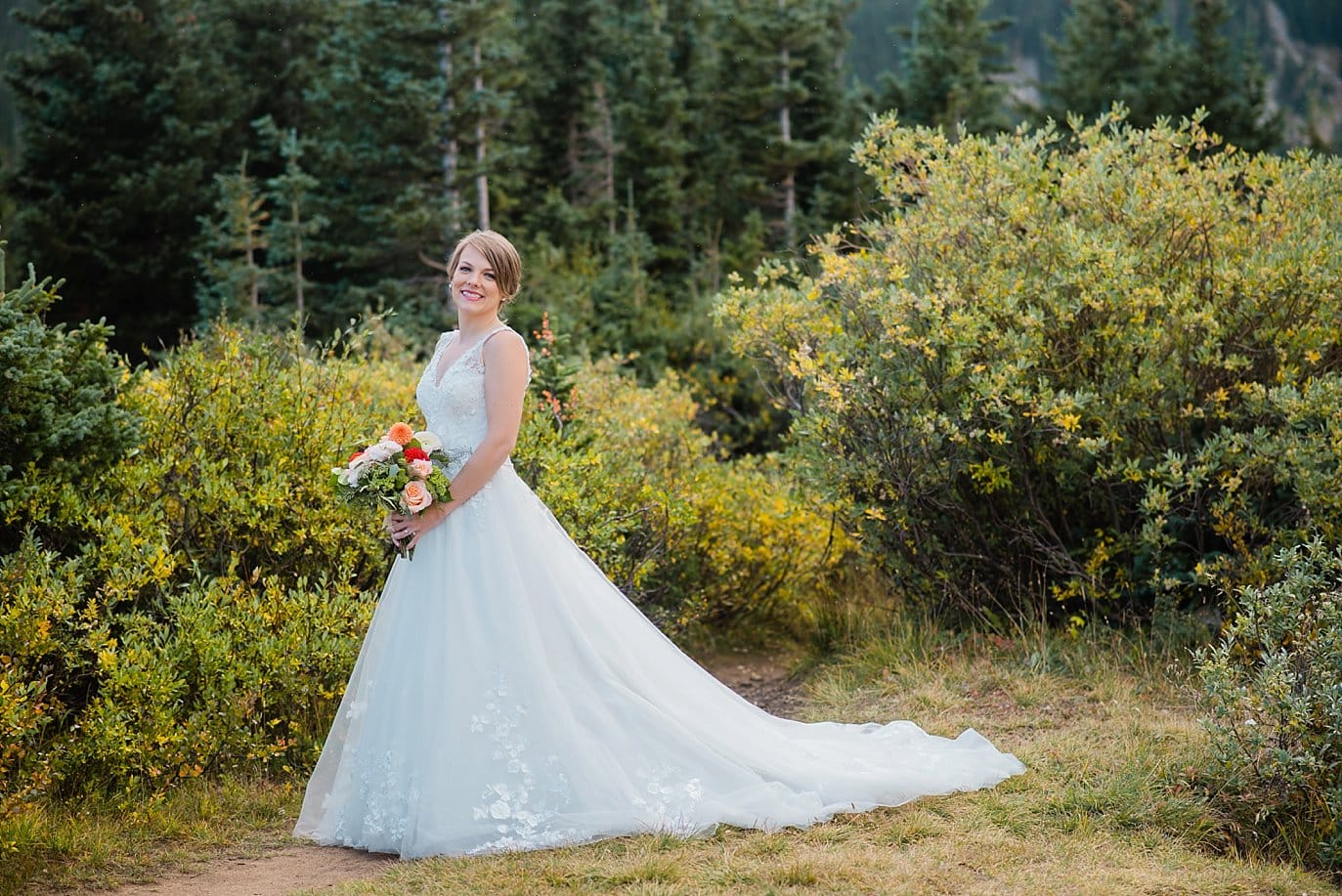bride in long lace and tulle ballgown at fall Colorado lakeside elopement