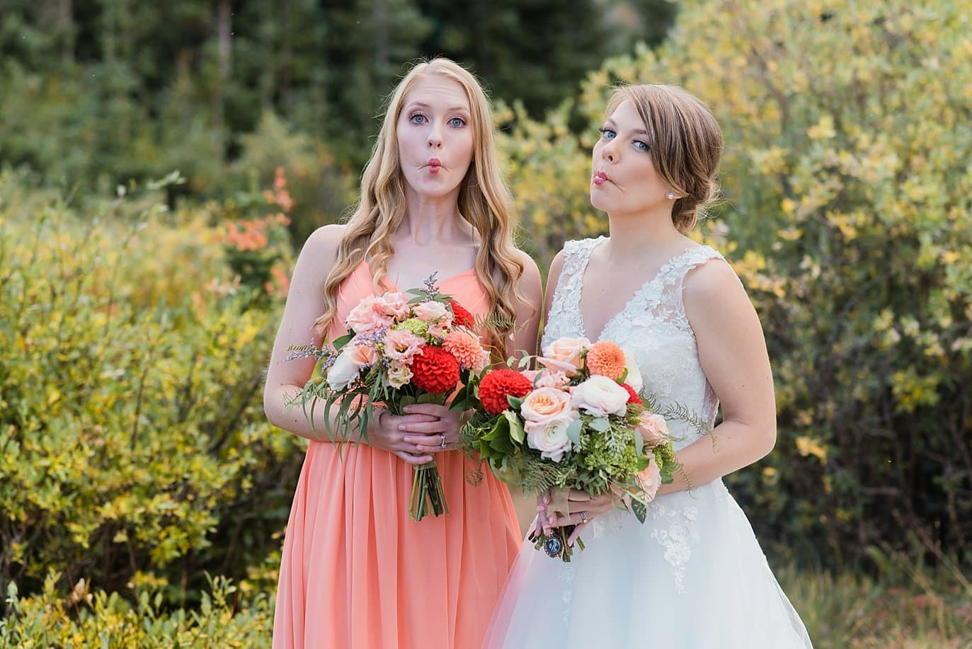 bride with bridesmaid in peach dress Colorado wedding