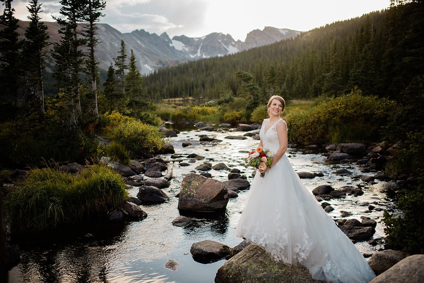 bride at sunset by Colorado Lake Elopement