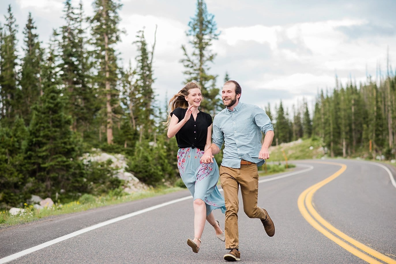 couple running down road in Medicine Bow National Forest photo