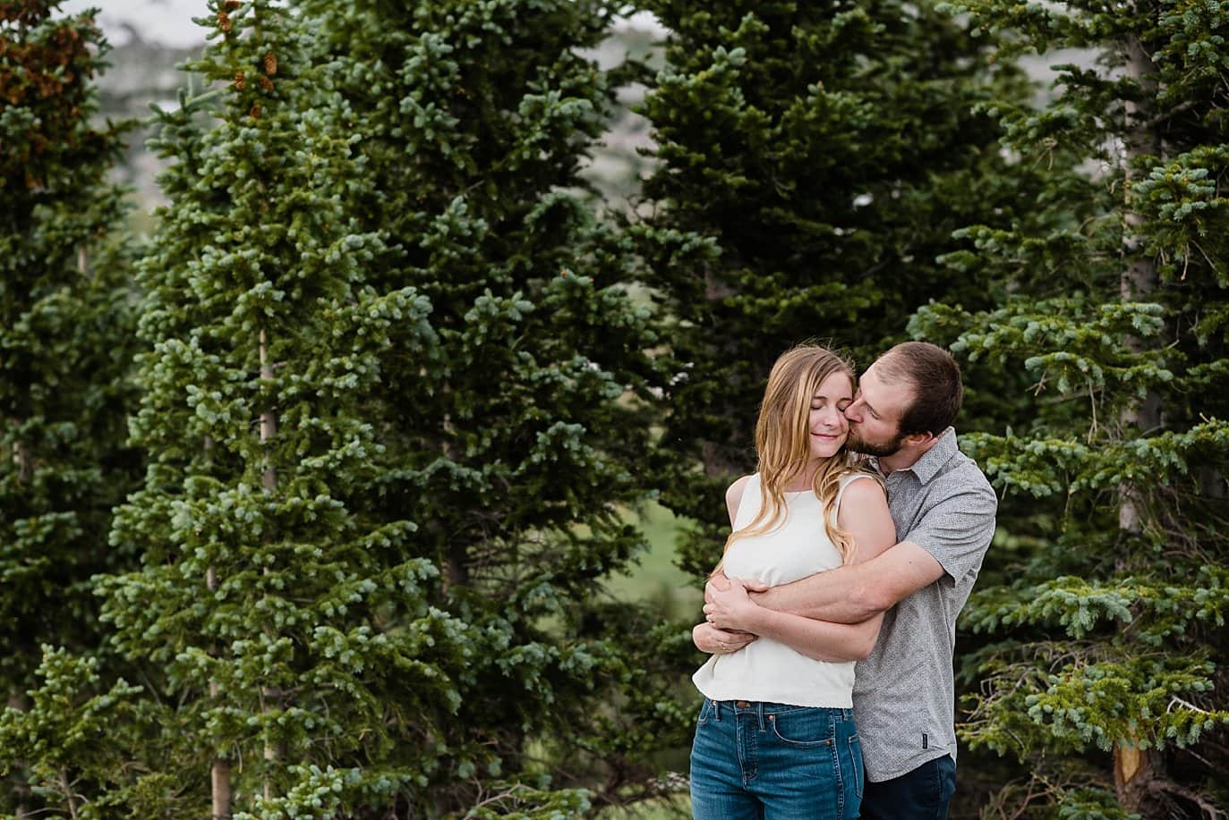 engagement photo in the pine trees photo