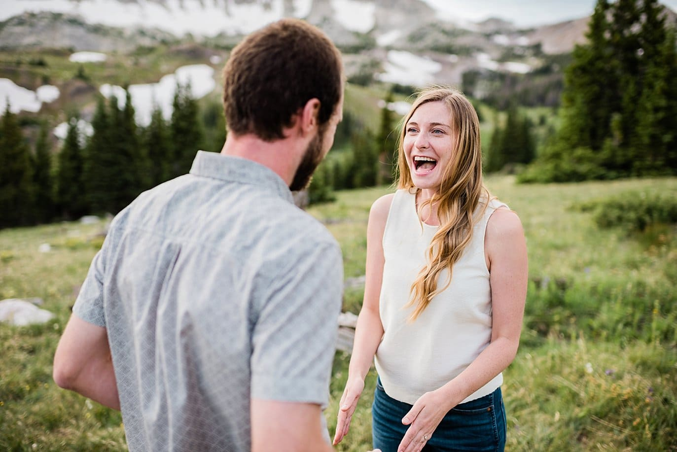 laughing outdoor engagement photo