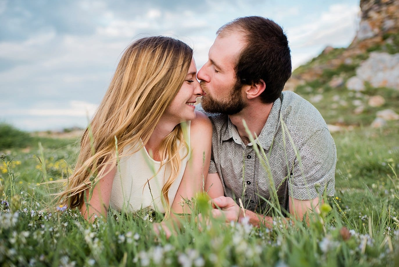cute nose kiss during engagement session photo