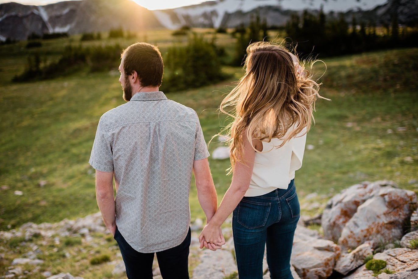 sunset wind in hair during engagement photo