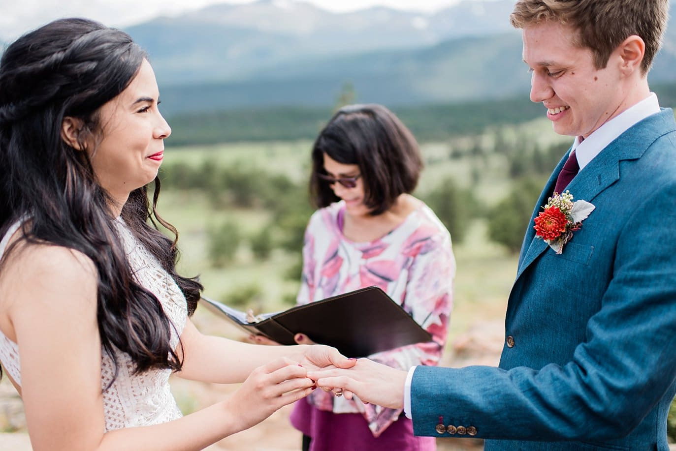 ring exchange at Rocky Mountain National Park Wedding by Estes Park Wedding Photography Jennie Crate