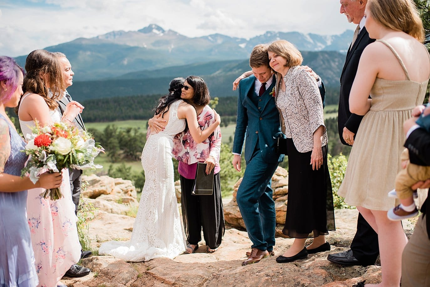 couples hugging parents at Rocky Mountain National Park Wedding by Rocky Mountain Colorado Wedding Photographer Jennie Crate