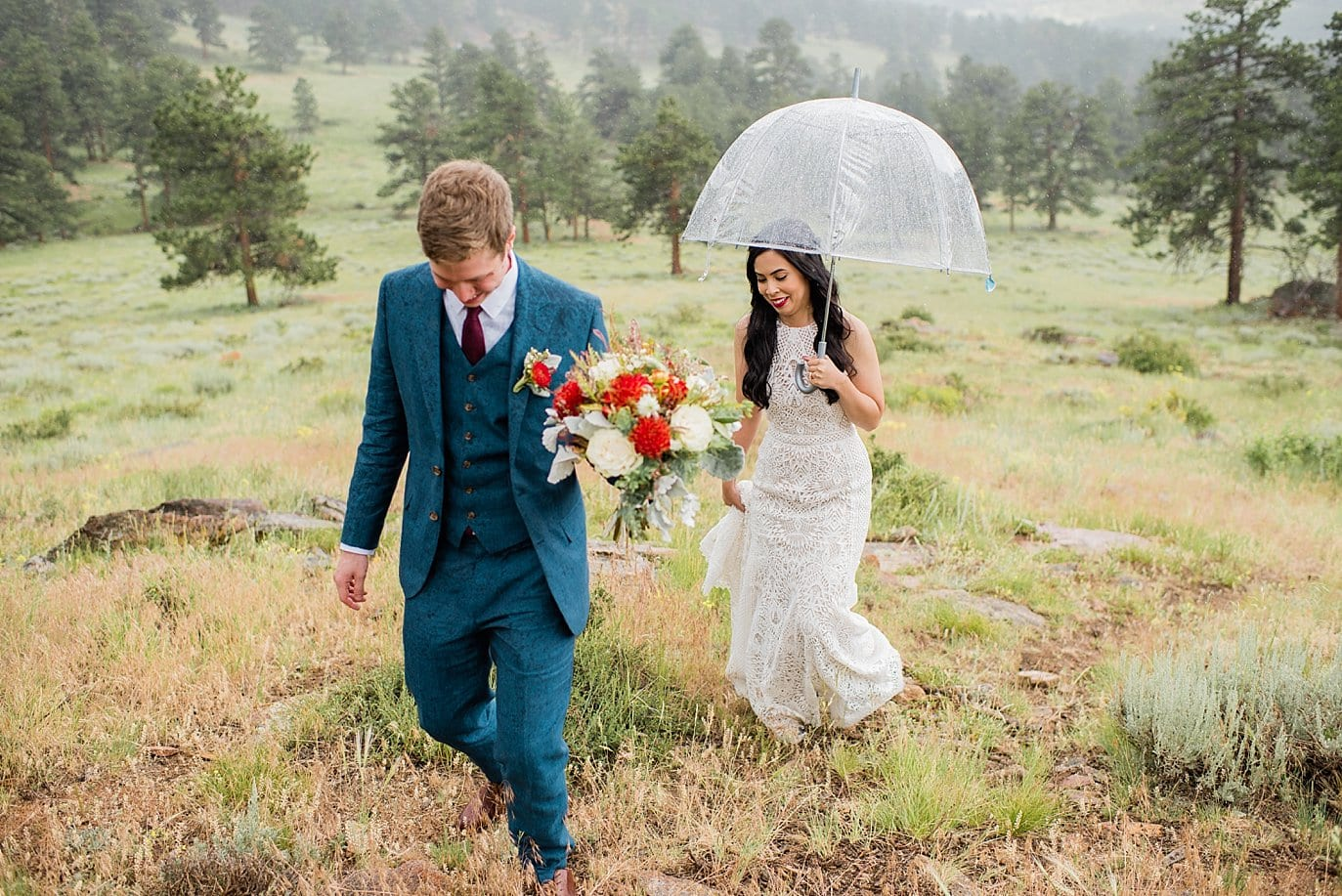 bride and groom in light rain  at Rocky Mountain National Park Wedding by Denver Wedding Photographer Jennie Crate