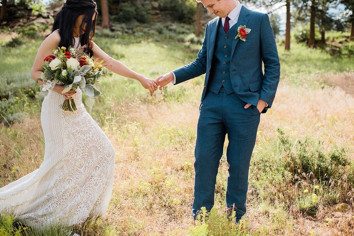 bride in lace dress  at Rocky Mountain National Park Wedding by Denver Wedding Photographer Jennie Crate