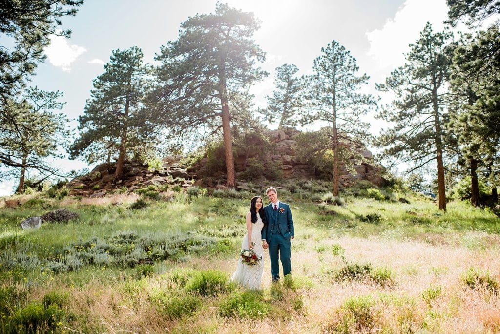 bride and groom in sunny Rocky Mountain National Park wedding by Breckenridge Wedding Photographer Jennie Crate photographer