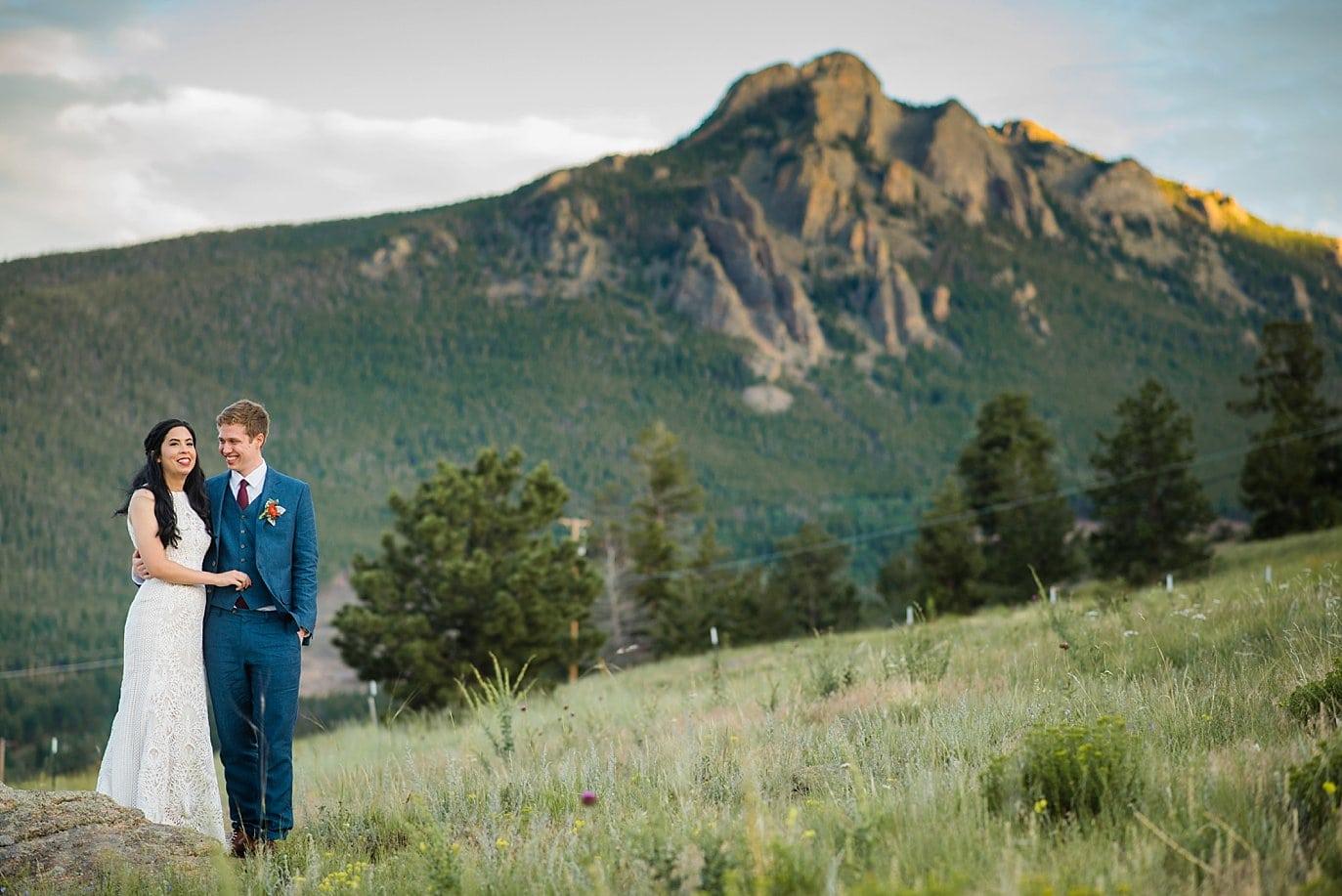 Taharaa Mountain Lodge sunset wedding couple at Rocky Mountain National Park Wedding by Rocky Mountain Colorado Wedding Photographer Jennie Crate