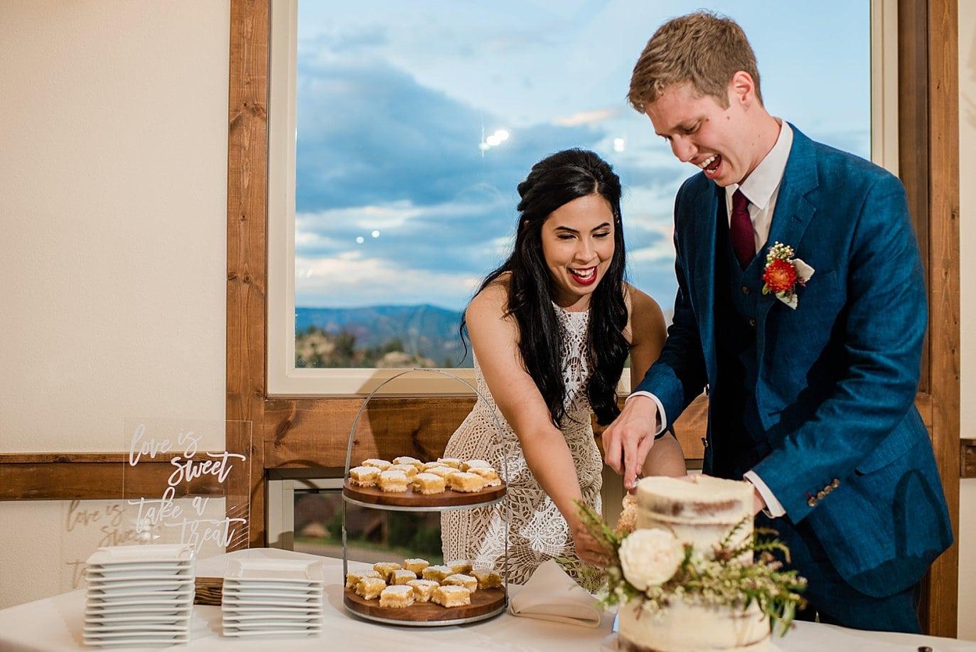 cake cutting at Taharaa Mountain Lodge at Rocky Mountain National Park Wedding by Rocky Mountain Colorado Wedding Photographer Jennie Crate