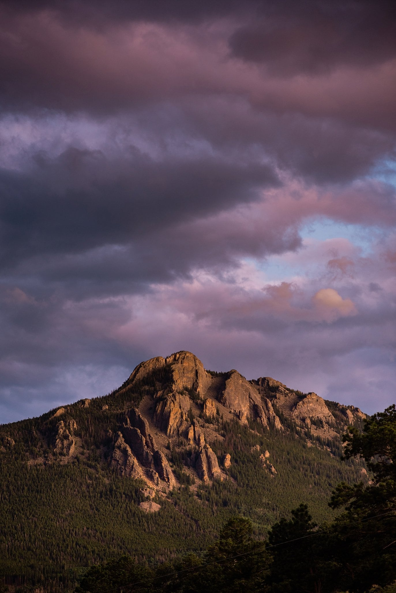 sunset with purple skies at Rocky Mountain Estes Park wedding by Estes Park Wedding Photography Jennie Crate