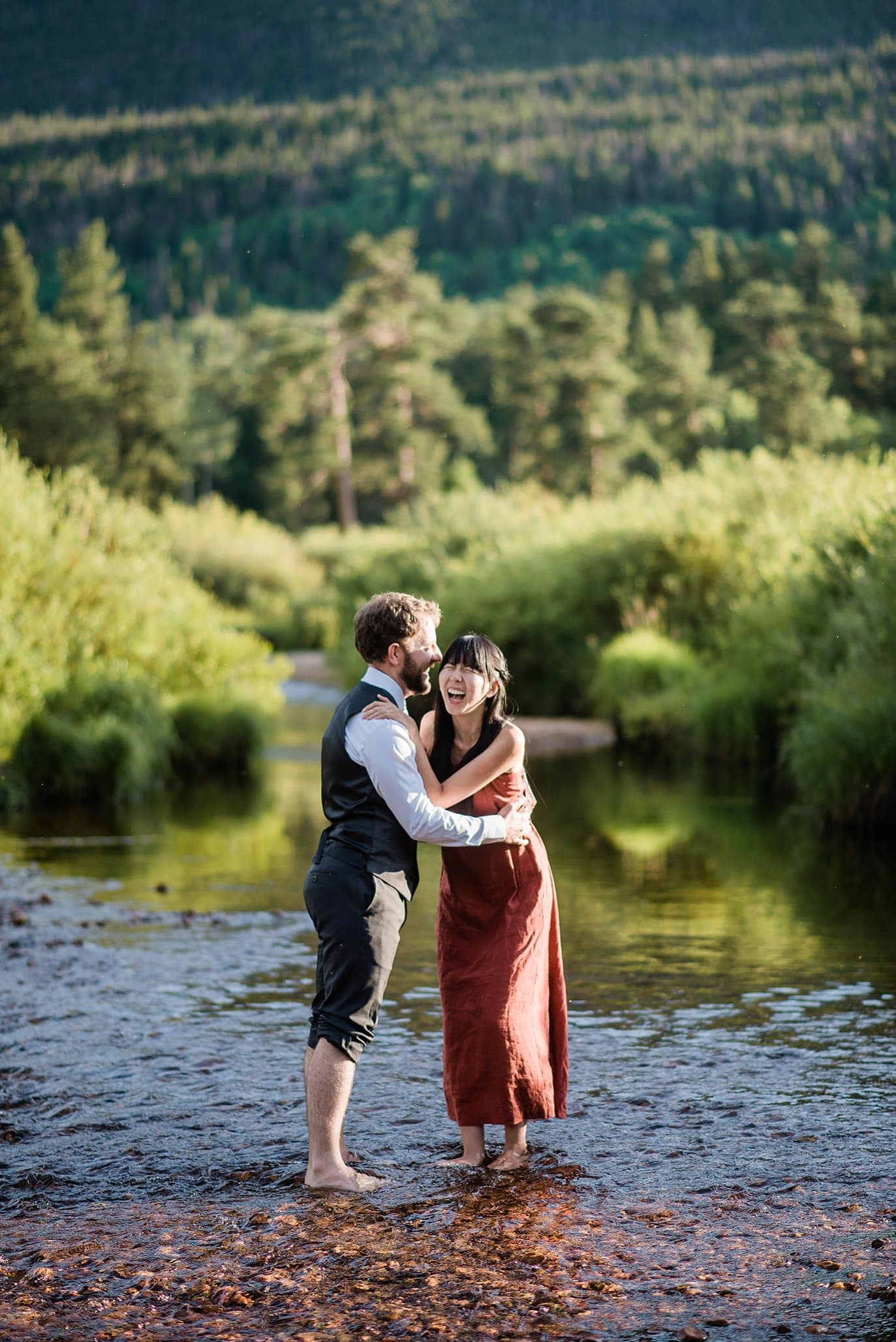 couple in river in Rocky Mountain National Park photo