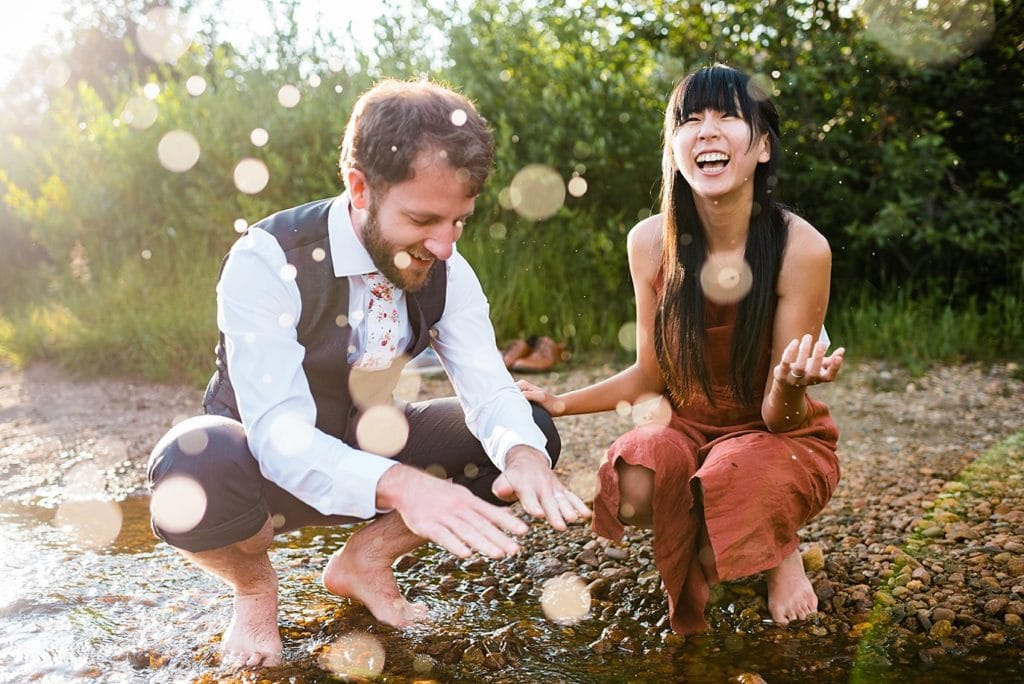 fun in a the creek in Rocky Mountain National Park photo by Estes Park engagement photographer Jennie Crate