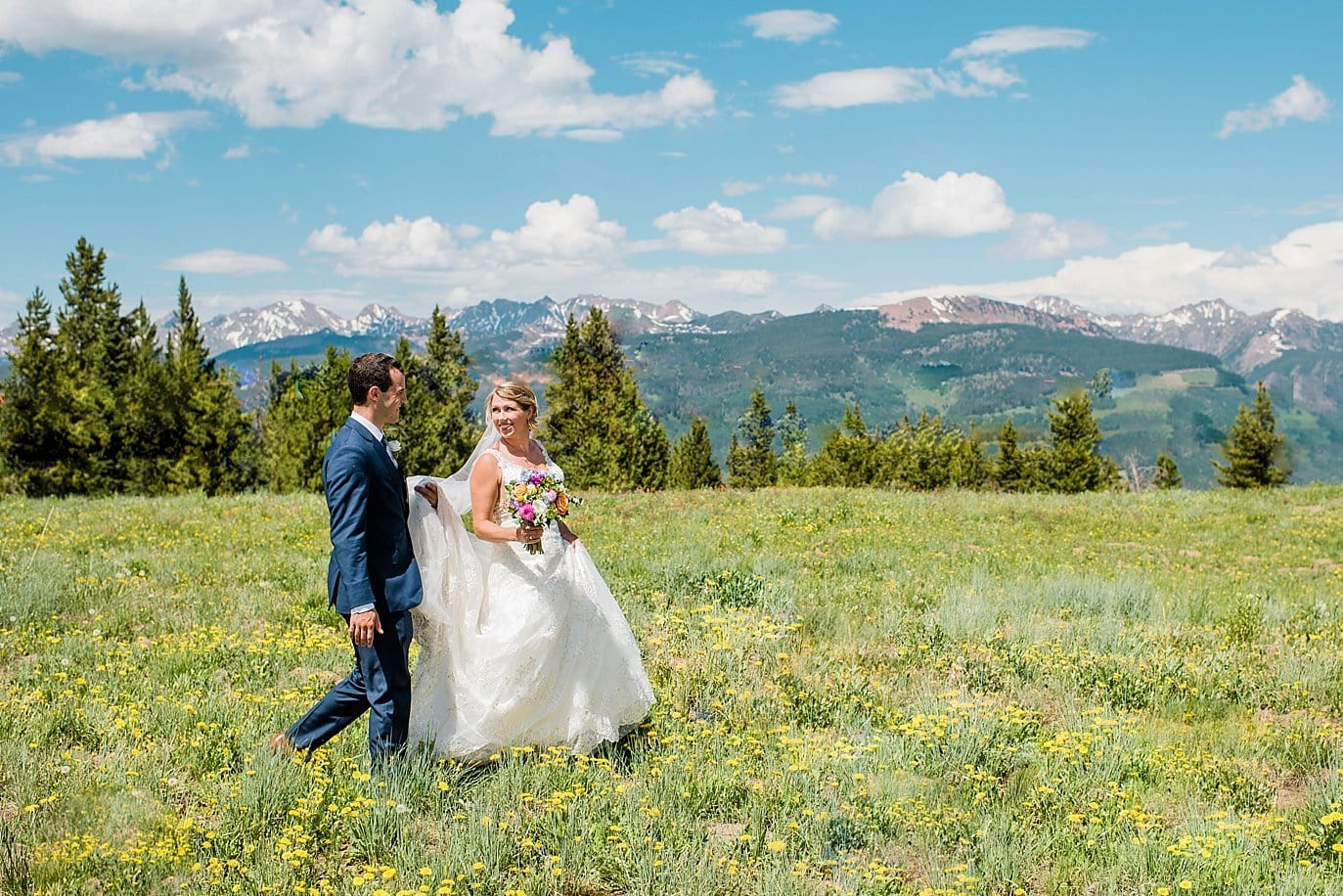 bride and groom at top of Vail Mountain summer wildflower photo