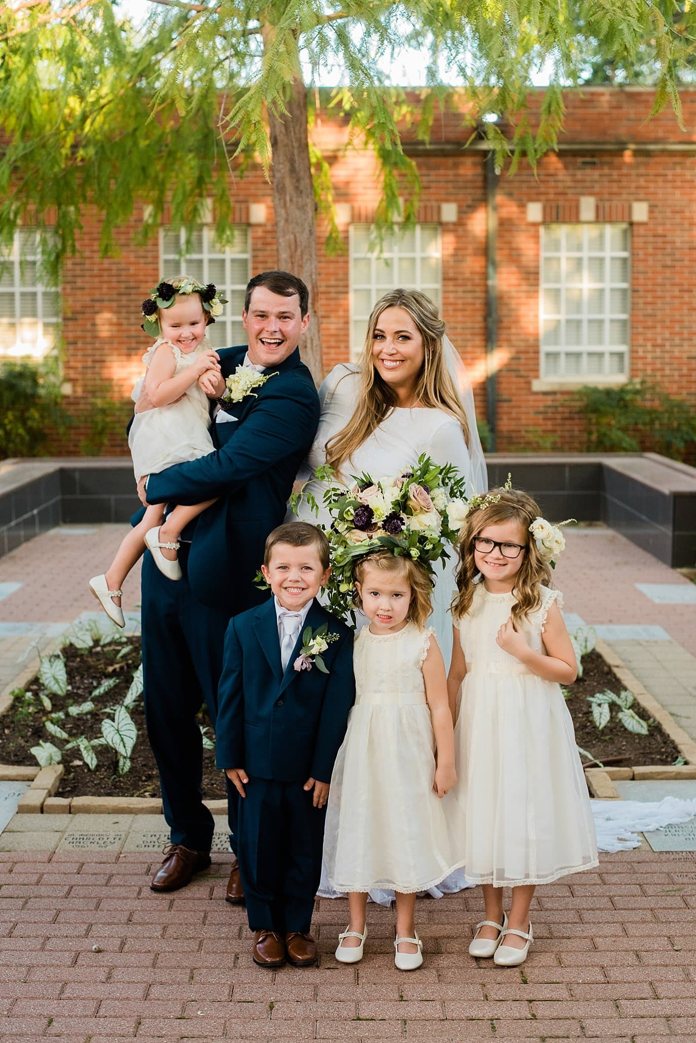 bridal party of ring bearers and flower girls at First Christian Church Wichita Falls wedding by Wichita Falls wedding photographer, Jennie Crate