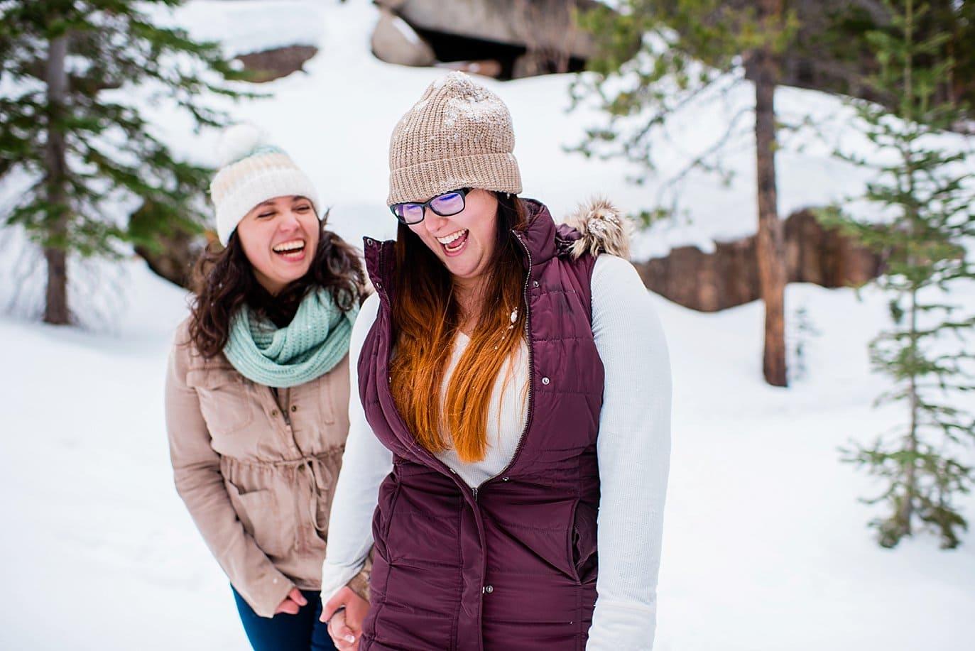 lesbian winter engagement at Alberta Falls Rocky Mountain National Park winter hiking engagement by Estes Park engagement photographer Jennie Crate, Photographer