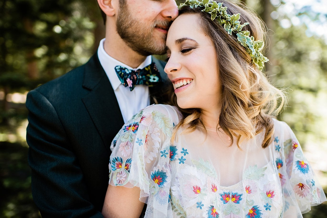 intimate portrait of bride and groom at Arapahoe Basin wedding by Frisco wedding photographer Jennie Crate