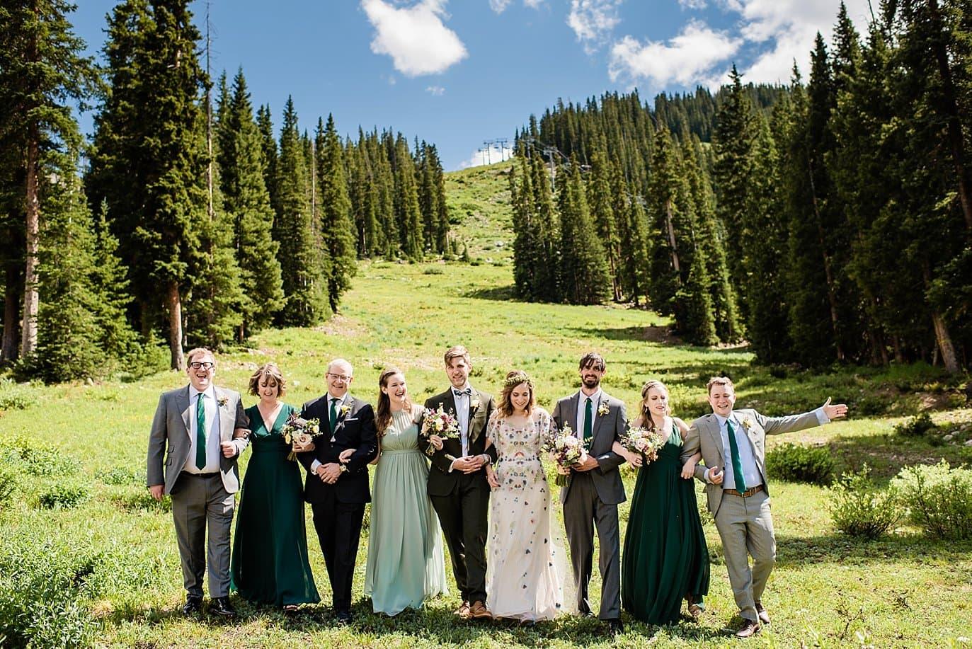 bridal party on slopes of mountain at Arapahoe Basin wedding by Arapahoe Basin wedding photographer Jennie Crate photographer