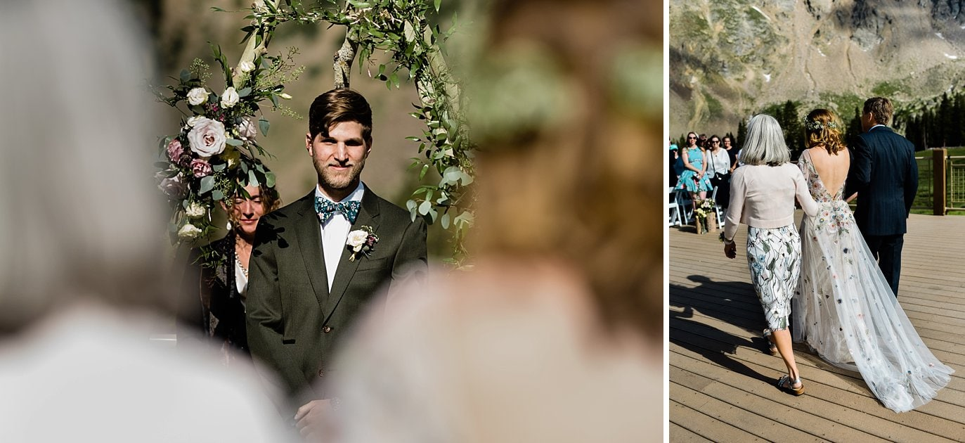 groom watching bride walk down aisle on outdoor deck of Black Mountain Lodge at Arapahoe Basin wedding by Arapahoe Basin wedding photographer Jennie Crate photographer