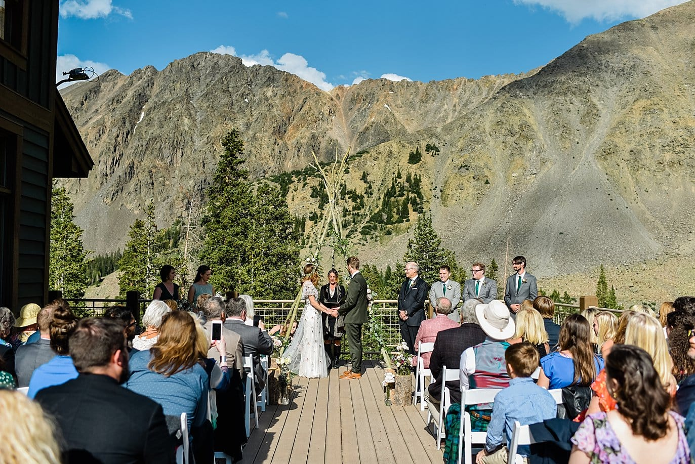 bride and groom outdoor ceremony at Black Mountain Lodge at Arapahoe Basin wedding by Black Mountain Lodge wedding photographer