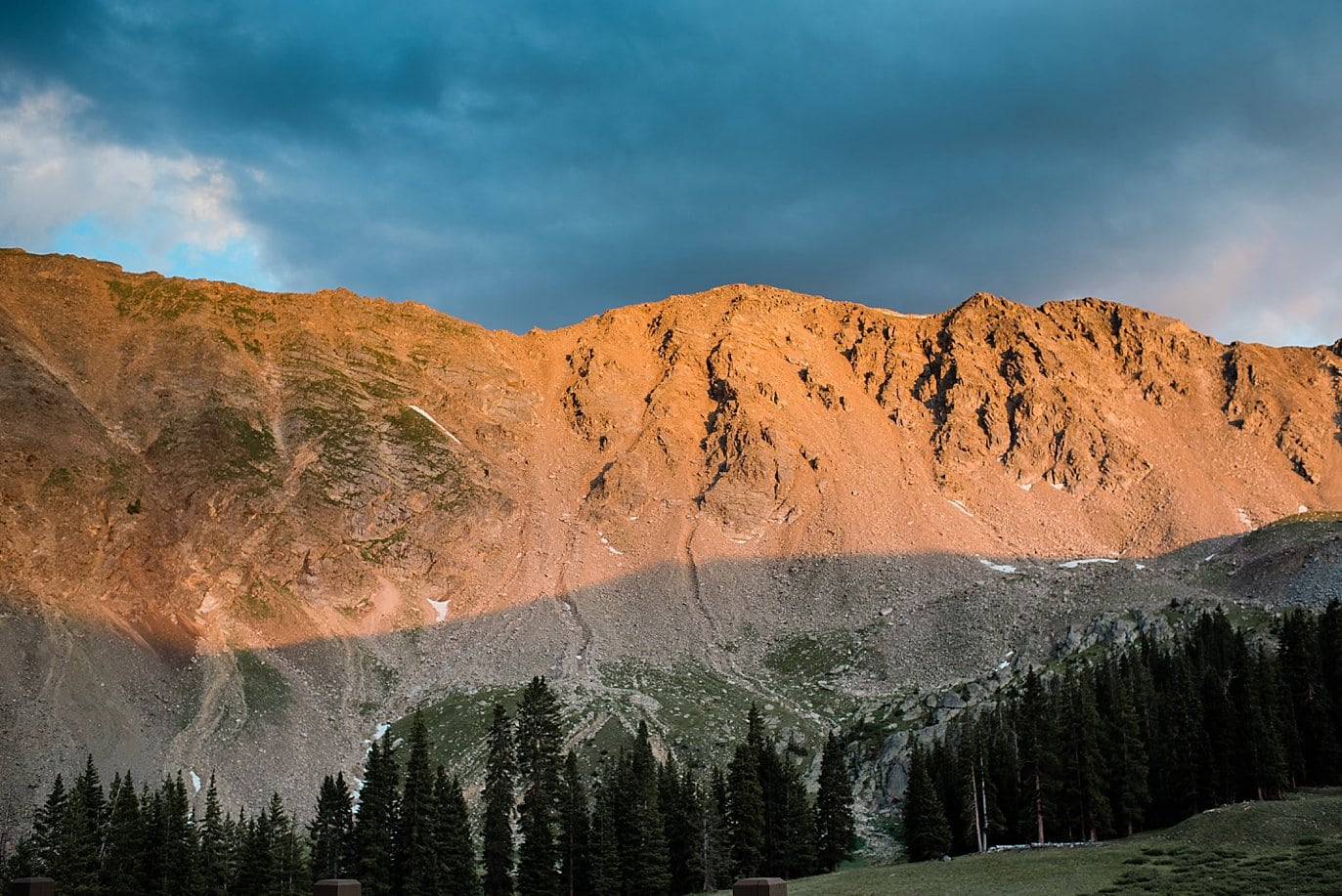 alpenglow Arapahoe Basin sunset at Arapahoe Basin wedding by Vail wedding photographer