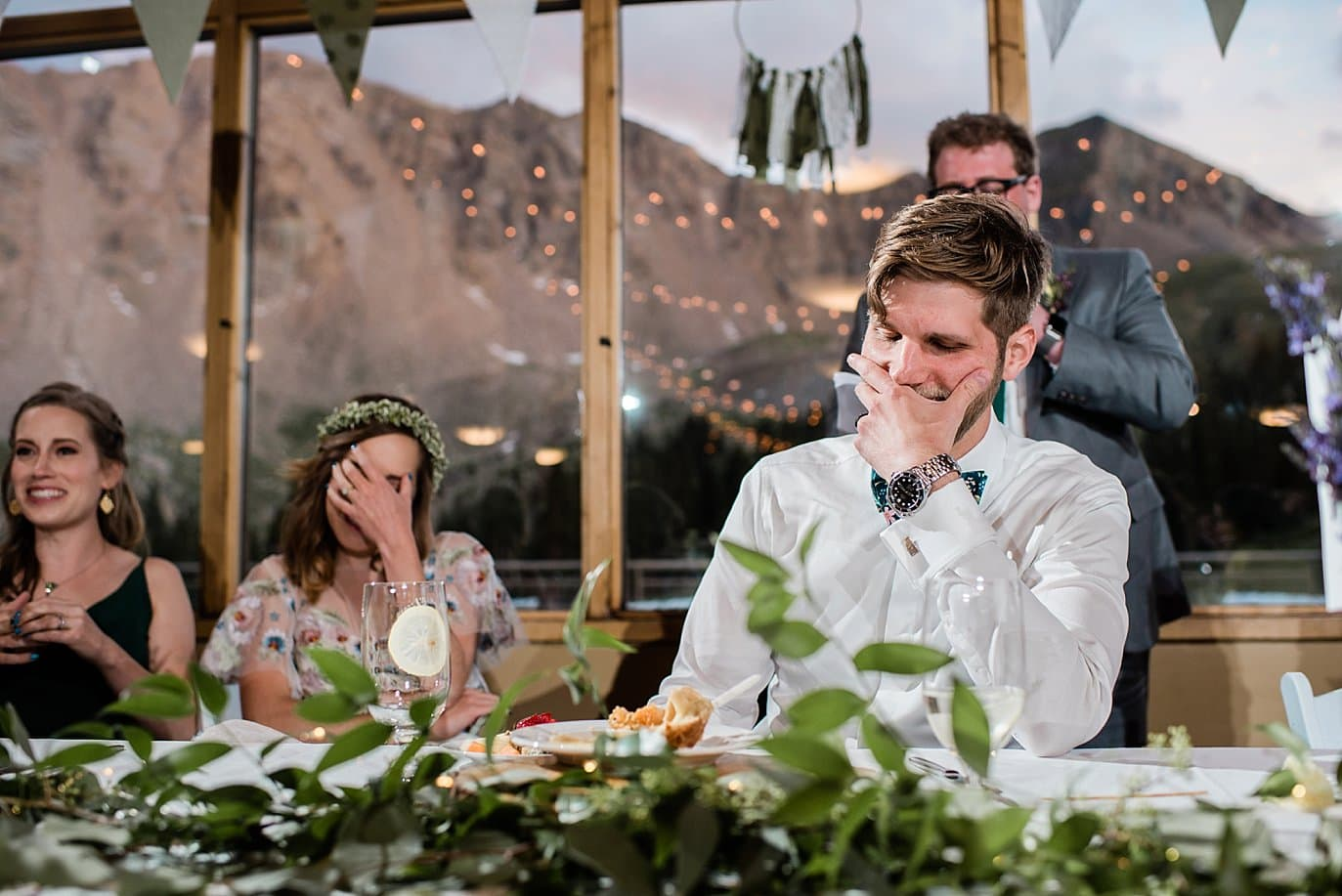 bride and groom get roasted during wedding reception at Black Mountain lodge wedding by Keystone wedding photographer Jennie Crate Photographer