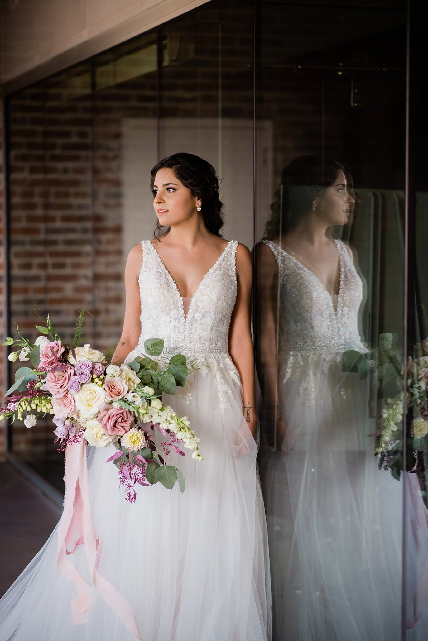 bride in beaded and tulle ballgown with lavender winter bridal bouquet at Shyft Denver wedding by Denver wedding photographer Jennie Crate photographer