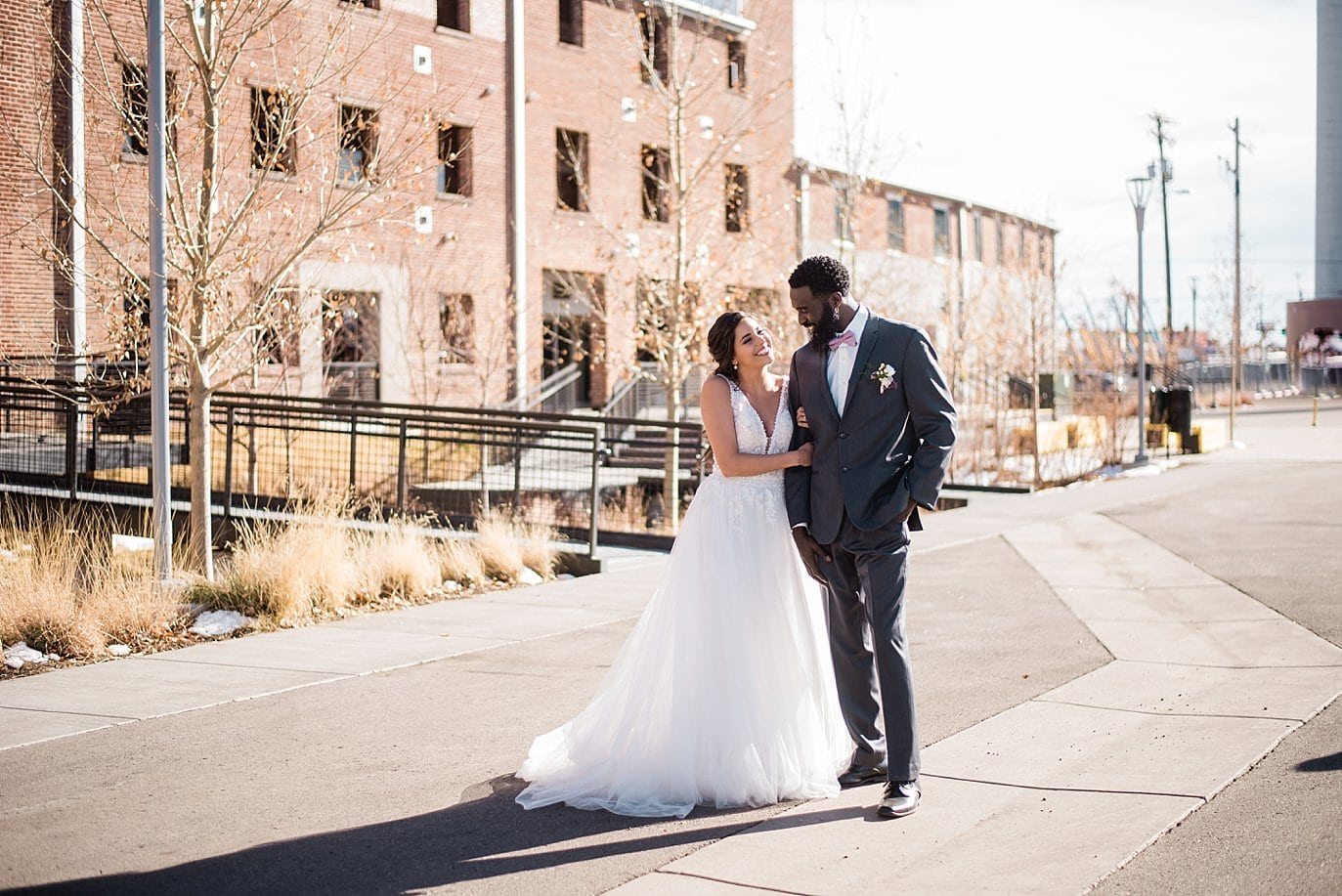 bride and groom in front of STEAM on the Platte event building at Shyft Denver wedding by Boulder Wedding photographer Jennie Crate photographer