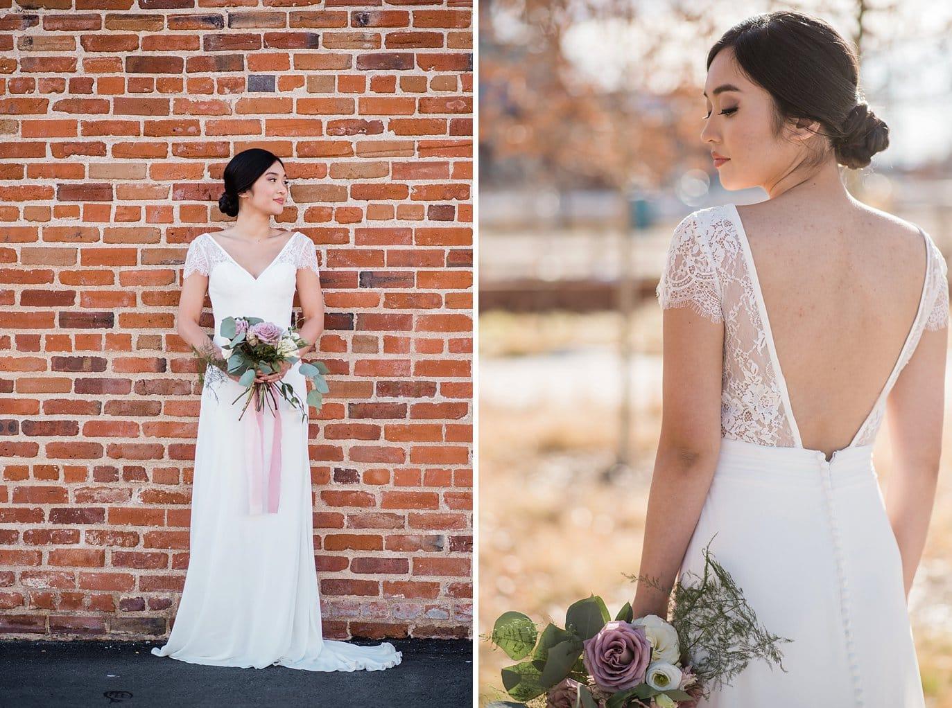 bride in sleek classy wedding dress with low plunging back wedding dress at Shyft Denver wedding by Boulder Wedding photographer Jennie Crate photographer