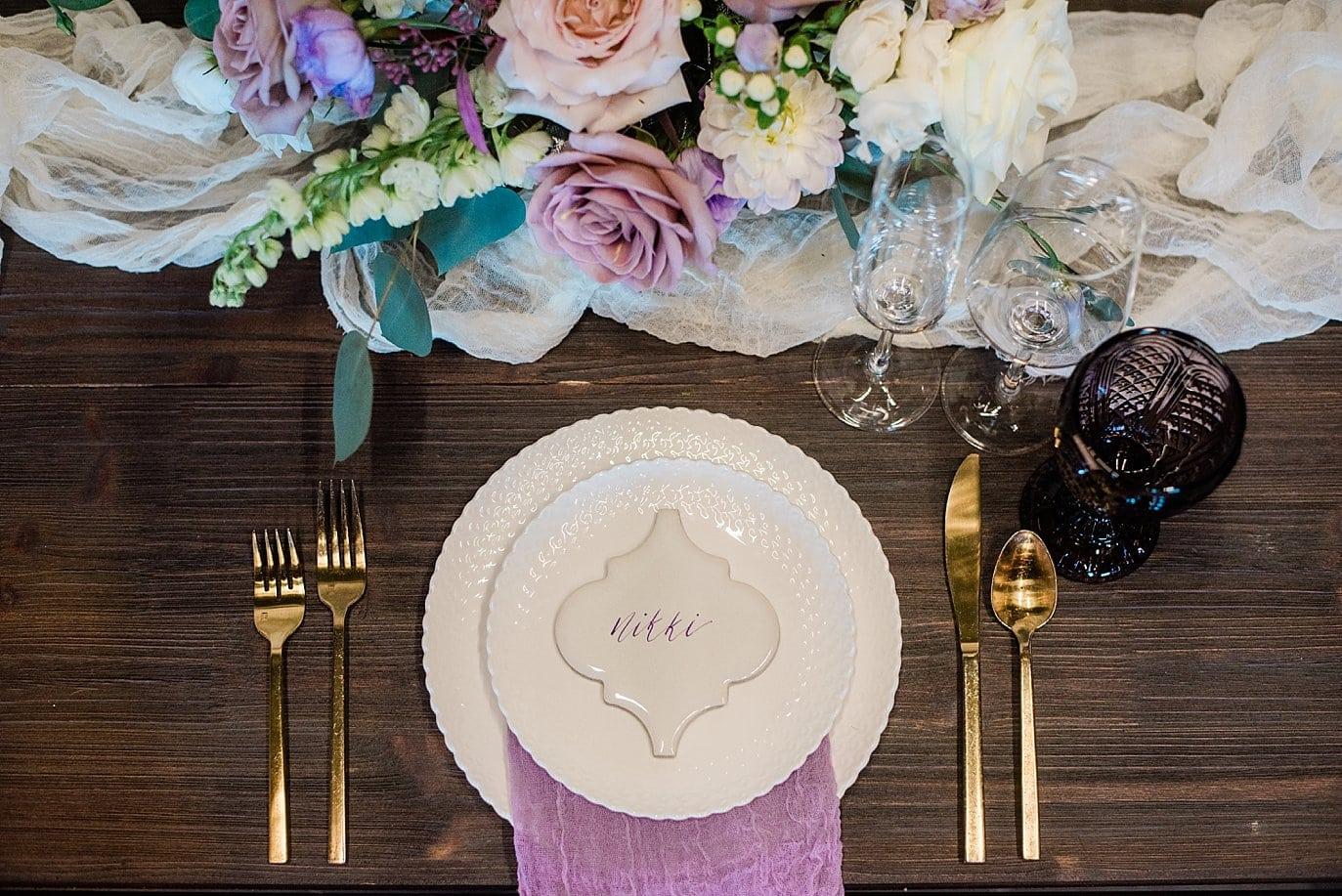 ceramic tile name plates and purple linen napkins at Shyft Denver wedding by Lyons wedding photographer Jennie Crate