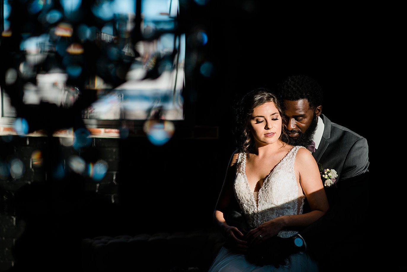 bride and groom creative portrait at Shyft Denver wedding by Lyons wedding photographer Jennie Crate