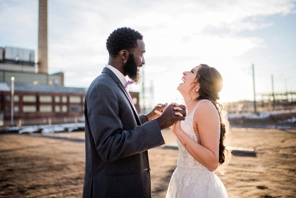 bride and groom laughing in sunset light at Shyft Denver wedding by Denver wedding photographer Jennie Crate