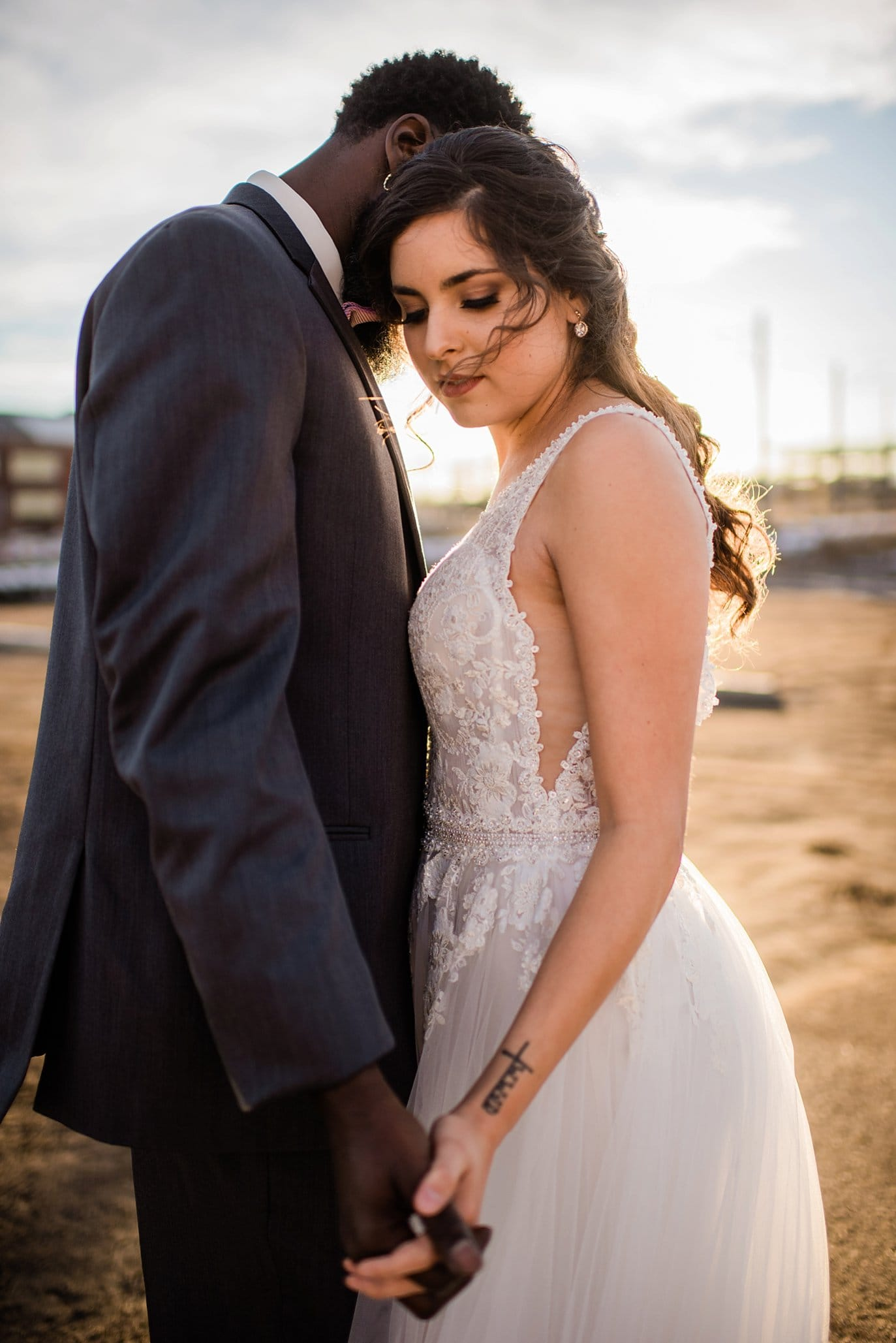 intimate bride and groom industrial wedding photo at Shyft Denver wedding by Aurora wedding photographer Jennie Crate photographer