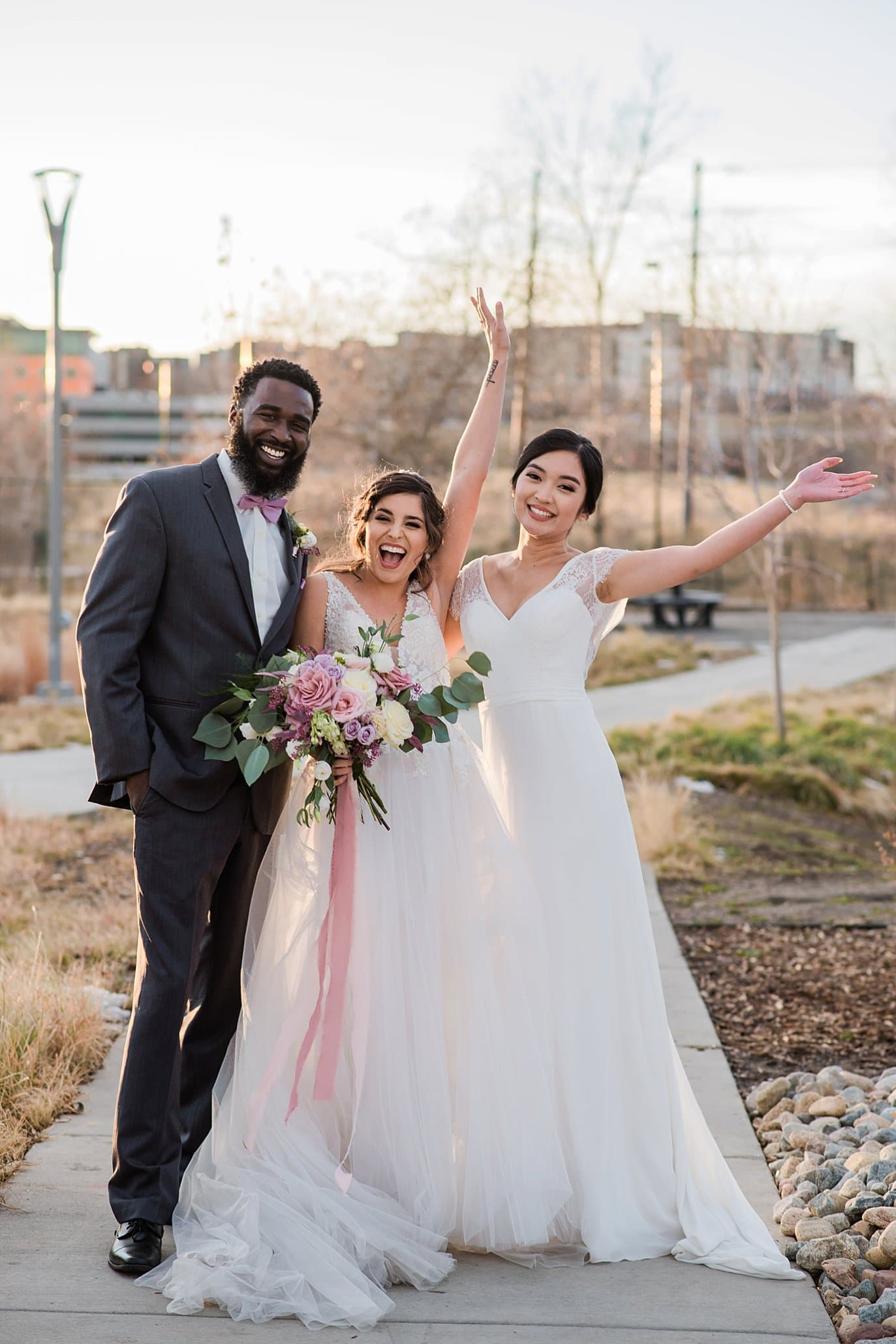 models posing after a successful styled shoot at Shyft Denver wedding by Aurora wedding photographer Jennie Crate photographer