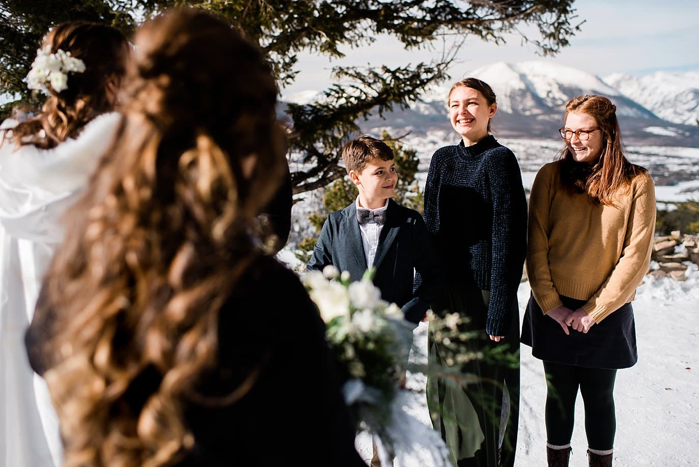 wedding ceremony with kids at Sapphire Point Elopement by Breckenridge wedding photographer Jennie Crate Photographer