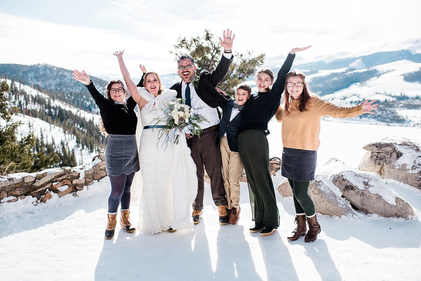 family celebrates after intimate wedding at Sapphire Point Elopement by Breckenridge wedding photographer Jennie Crate Photographer