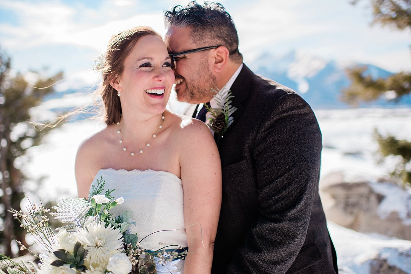 bride and groom intimate moment after ceremony at Sapphire Point Elopement by Vail wedding photographer Jennie Crate Photographer