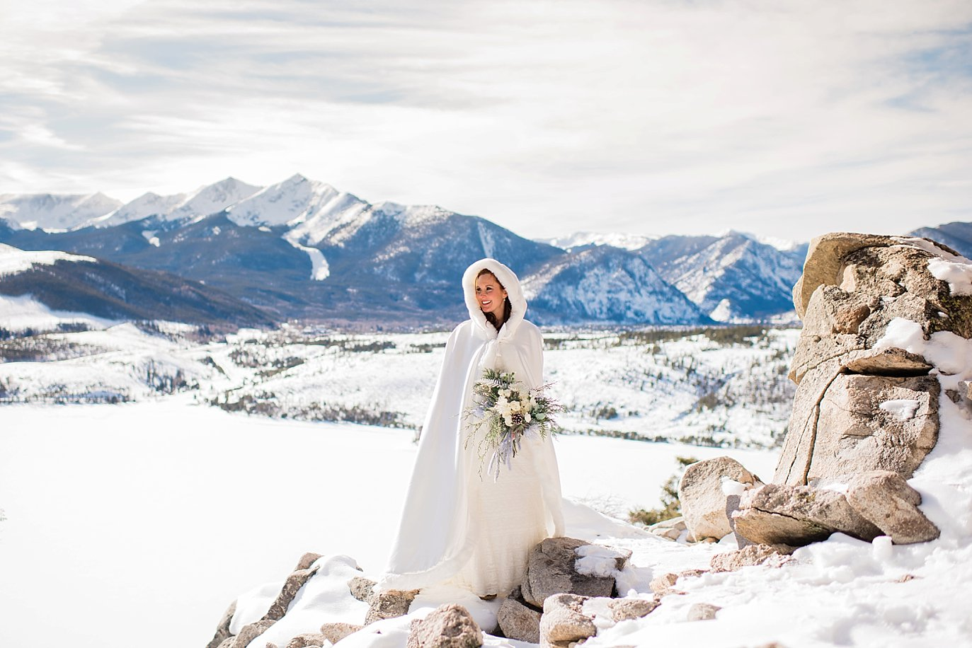 bride in white winter cape over wedding dress at Sapphire Point Elopement by keystone wedding photographer Jennie Crate Photographer