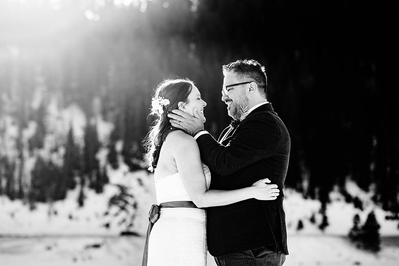 bride and groom romantic portrait on Lake Dillon in winter at Sapphire Point Elopement by Keystone wedding photographer Jennie Crate Photographer